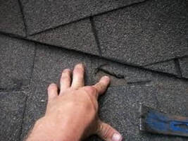 man's hands repairing roof