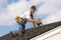 man working on roof