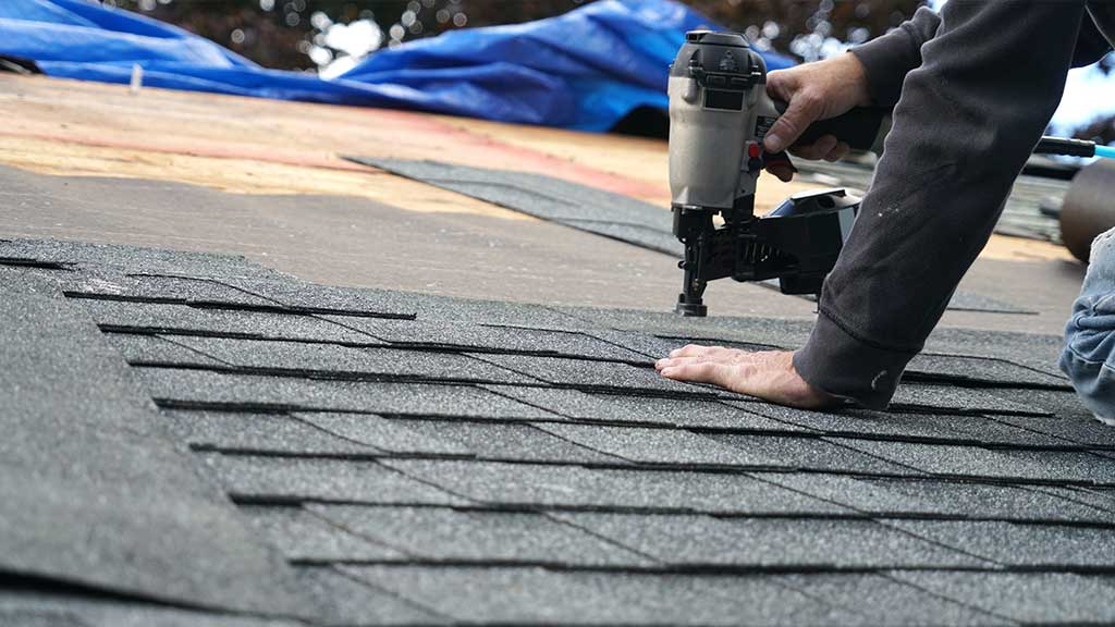 roofer stapling shingles